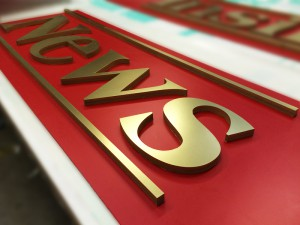 gold finish lettering  shop sign in grays essex